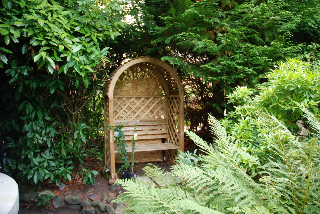 Hole in hedge filed with nice arbour